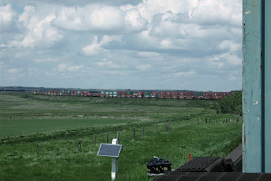 view of doublestack train on prairie